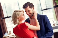 Young couple on date in restaurant dancing. Young men and women on date in restaurant dancing together royalty free stock photography