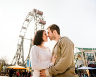 Young couple dating in amusement park Royalty Free Stock Photo