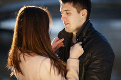 Young couple dating in the city park Stock Photos