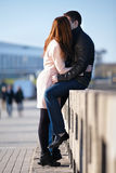 Young couple dating and kissing in the city park Royalty Free Stock Images