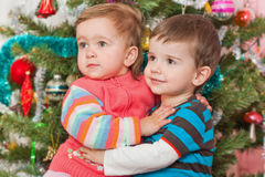Young couple at the decorated christmas tree Stock Photos