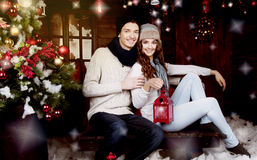 Young couple decorating Christmas tree Stock Photos