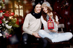 Young couple decorating Christmas tree Royalty Free Stock Photography