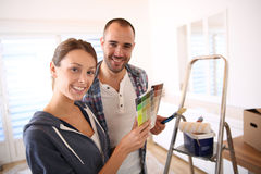 Young couple decorating their new flat stock images