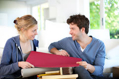 Young couple decorating their new house Stock Photo