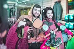 Young couple demonstrating tourist equipment Royalty Free Stock Photos