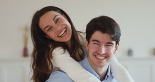 Young couple with dental smiles laughing together looking at camera