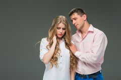 The young couple with different emotions during conflict Royalty Free Stock Images