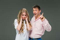 The young couple with different emotions during conflict Stock Image
