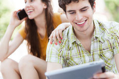 Young couple with digital tablet Stock Images