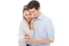 Young couple with digital tablet Royalty Free Stock Images