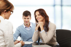 Young couple discussing financial plan with consultat. Contemporary young couple get financial advise Royalty Free Stock Photo