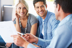 Young couple discussing investment plans Stock Images