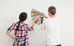 Young couple discussing a renovation of a home Royalty Free Stock Images