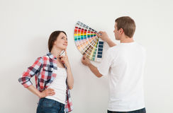 Young couple discussing a renovation of a home Stock Photography