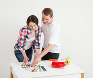 Young couple discussing a renovation of a home Royalty Free Stock Photos