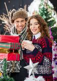 Young Couple With Disposable Cups And Christmas Royalty Free Stock Image