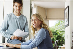 Young Couple With Documents And Computer Royalty Free Stock Photography