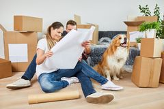 Young couple with dog and construction drawing. While planning house construction or purchase royalty free stock images