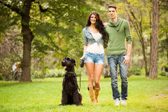Young Couple With A Dog Royalty Free Stock Photo