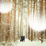 Young Couple with a Dog Having Fun in Winter Royalty Free Stock Photo