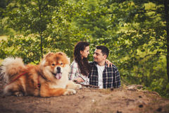 Young couple and a dog outdoor Royalty Free Stock Photography