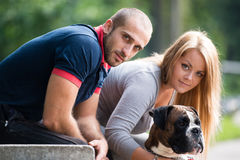 Young Couple With Dog Royalty Free Stock Photography