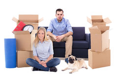 Young couple with dog ready for moving day isolated on white Stock Photography