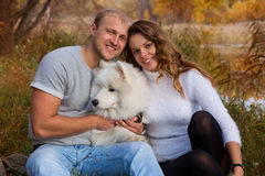 Young couple with a dog Royalty Free Stock Images