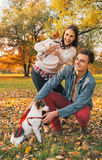Young couple with dogs pointing on copy space outdoors in park Stock Images