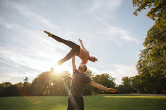 Young couple doing acroyoga at the park stock photos