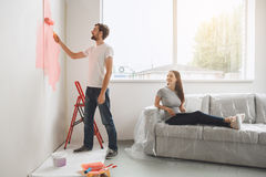 Young couple doing apartment repair together themselves Royalty Free Stock Images