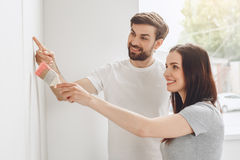Young couple doing apartment repair together themselves Stock Image