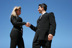 Young couple doing business. Young successful businessman and businesswoman as team Stock Photos
