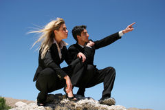 Young couple doing business. Young successful businessman and businesswoman as team Stock Photography
