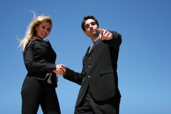 Young couple doing business. Young successful businessman and businesswoman as team Royalty Free Stock Photography