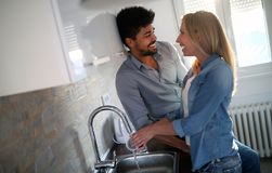 Young couple doing dishes in the kitchen. And smiling Royalty Free Stock Photo