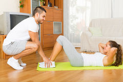 Young couple doing exercises together stock image