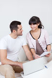 Young couple doing finances at laptop Stock Images