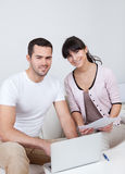 Young couple doing finances at laptop Royalty Free Stock Photography