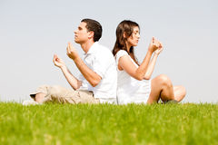 Young couple doing meditating Royalty Free Stock Photo