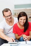 Young couple doing paperwork at home Stock Image
