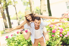 Young couple doing piggyback in the park Royalty Free Stock Images