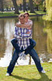 Young couple doing piggyback ride stock photography