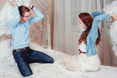Young couple doing pillow fight Royalty Free Stock Photography