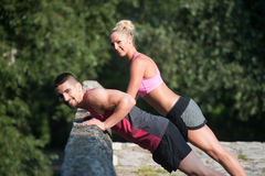 Young Couple Doing Push Ups Outdoor Royalty Free Stock Photos