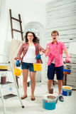 Young couple doing repair at home Stock Photos