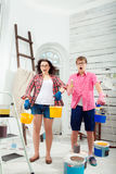 Young couple doing repair at home Stock Photo