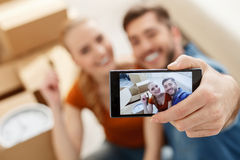 Young couple doing selfie Royalty Free Stock Image