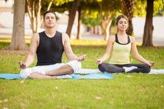 Young couple doing some yoga Stock Image